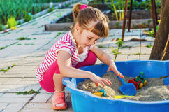 Little girl playing in a sandbox Royalty Free Stock Images