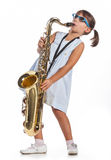 Little girl playing saxophone Stock Photos