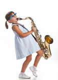 Little girl playing saxophone Royalty Free Stock Images