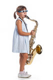 Little girl playing saxophone Royalty Free Stock Photo