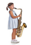 Little girl playing saxophone Royalty Free Stock Image