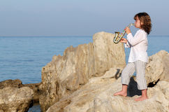 Little girl playing saxophone Stock Photography