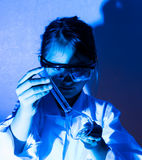 Little girl playing scientist with  flask Stock Image