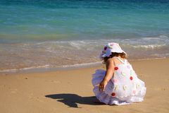 Little girl playing by the sea Royalty Free Stock Photography