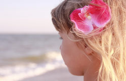 Little girl playing on the sea shore Royalty Free Stock Photos
