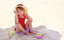 Little girl playing on the sea shore Stock Photography