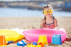 Little girl playing on the sea shore. Stock Photo