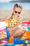 Little girl playing on the sea shore. Royalty Free Stock Photo