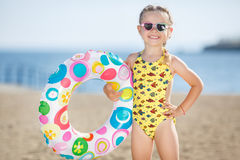 Little girl playing on the sea shore. Stock Image