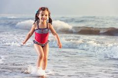 Little Girl Playing At Sea  Side Stock Images
