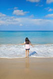 Little girl playing sea wave Royalty Free Stock Photo