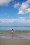 Little girl playing sea wave Royalty Free Stock Image