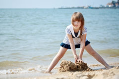 Little girl playing at the seaside Royalty Free Stock Photography