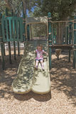 Little Girl Playing on a Slide Royalty Free Stock Images