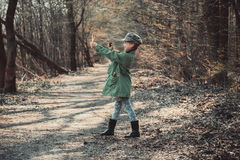 Little girl playing with a slingshot Stock Photos