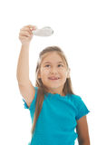 Little girl playing small plane Stock Photos