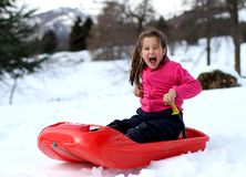 Little girl playing in the snow with the bob Royalty Free Stock Photography