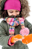 Little girl playing with snow Royalty Free Stock Images