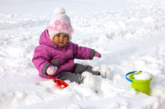 Little girl playing with snow outdoors royalty free stock image