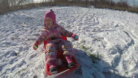 Little girl playing in the snow stock footage