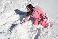 Playing in the snow. Little girl playing in the snow, Pyrenees, Spain Royalty Free Stock Photos