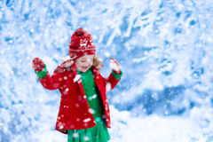 Little girl playing in snow Stock Photography