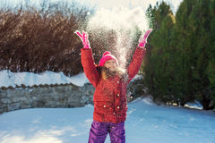 Little girl playing with snow. Selective focus Royalty Free Stock Photography
