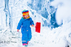 Little girl playing with snow in winter Royalty Free Stock Photo