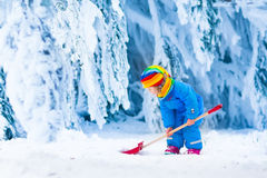 Little girl playing with snow in winter Royalty Free Stock Images
