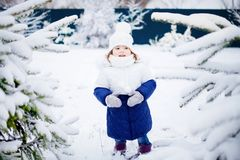 Little girl playing snowballs, winter activity. Stock Photography
