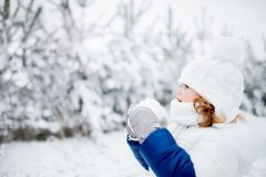 Little girl playing snowballs, winter activity. Little girl playing snowballs, winter activity for kids Royalty Free Stock Photos