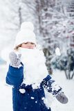 Little girl playing snowballs, winter activity. Little girl playing snowballs, winter activity for kids Royalty Free Stock Image