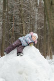 Little girl playing on snowy hill in beautiful Stock Photography