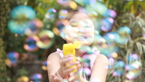 Little Girl Playing with Soap Bubbles, Outdoor Having Fun stock video footage