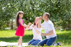 Little girl is playing with soap bubbles. stock photos