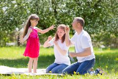 Little girl is playing with soap bubbles. royalty free stock image