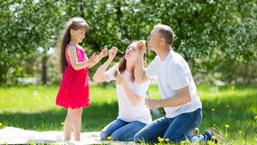 Little girl is playing with soap bubbles. royalty free stock photos