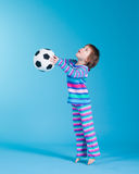 Little girl playing with soccer ball royalty free stock photography