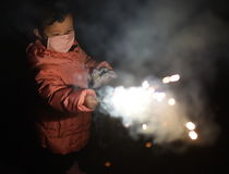 Little girl playing sparkler Stock Image