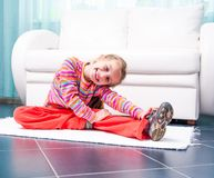Little girl playing sports at home Royalty Free Stock Images
