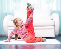 Little girl playing sports at home Stock Photo