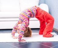 Little girl playing sports at home Stock Photography