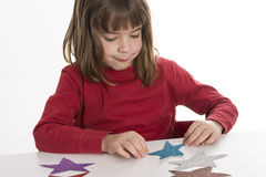Little girl playing with stars Stock Photography