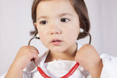 Little girl playing with a stethoscope Royalty Free Stock Image