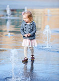 Little girl playing in street fountain Royalty Free Stock Images