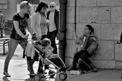 Little girl playing on the street in Krakow Stock Photo