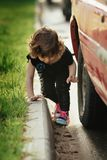 Little girl playing in the street on road Royalty Free Stock Photos