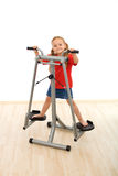 Little girl playing on stretcher device in the gym Stock Photography