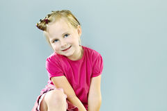 Pretty small girl in studio. Little girl playing in studio on background posing for portrait photos stock images