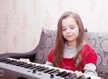 Little girl playing on a synthesizer Royalty Free Stock Photography